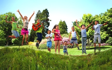 bigstock-Happy-Kids-Jumping-On-Summer-F-47779420